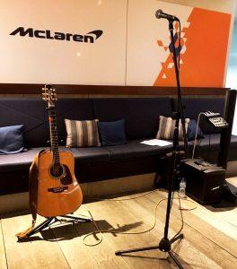 acoustic guitar and singer setup