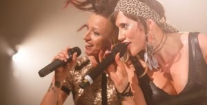 Two female vocalists singing at a wedding