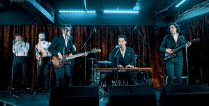 Retro wedding band live on stage