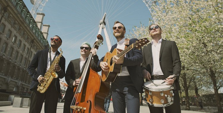 A fully acoustic band busking in London