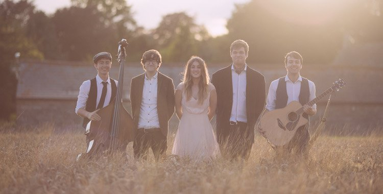 Mumford and Sons style band in a field