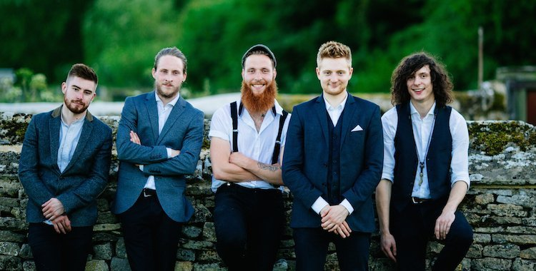 Surrey based covers band by a wall