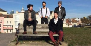 Hampshire based Mumford style band sitting on a bench