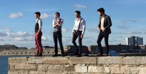 Hampshire based Mumford style band The Lion Men walking on a wall