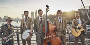Roaming wedding band standing by the Thames