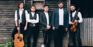 Mumford & Sons style wedding band by a barn
