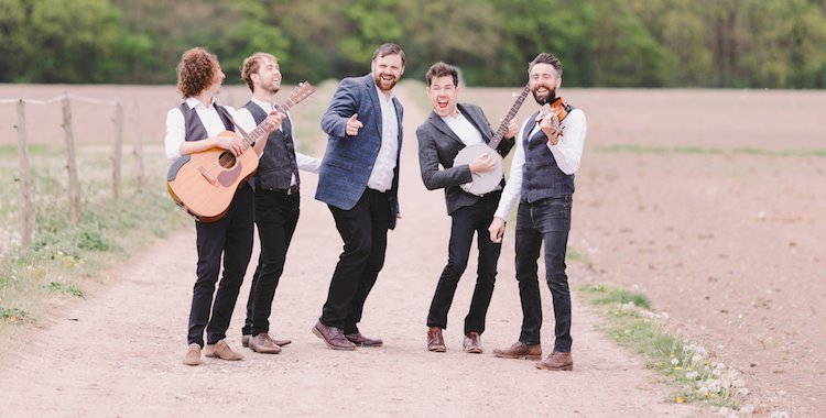 A folky wedding band on a road with banjo
