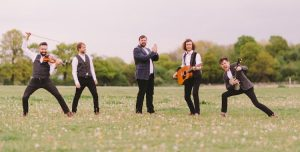 Mumford & Sons style wedding band in a field