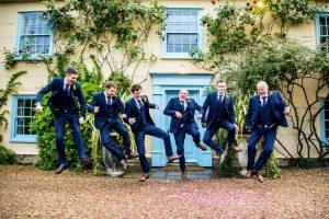 groomsmen jumping photo