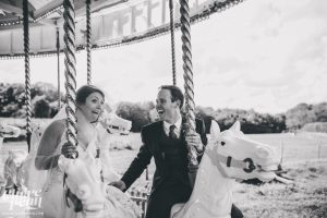 bride-and-groom-on-carousel
