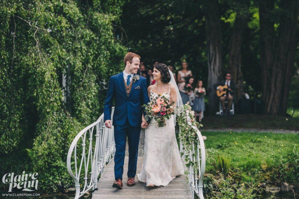 Vintage Bride and groom on a bridge