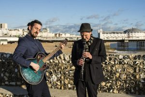 A jazz duo playing on Brighton beach