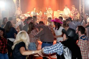 Line dancing to a country band