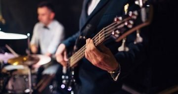a man playing a guitar at a wedding.